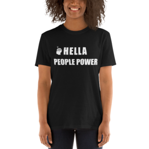 "Person wearing a black unisex t-shirt that says ""Hella People Power"" in large bold font across the chest. Also shows the CDP logo, which is the silhouette of a head with the Oakland tree as a brain and a lightbulb over the head."