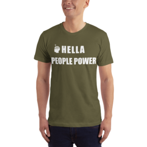"Person wearing an olive green unisex t-shirt that says ""Hella People Power"" in large bold font across the chest. Also shows the CDP logo, which is the silhouette of a head with the Oakland tree as a brain and a lightbulb over the head."